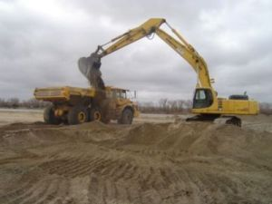 Photo of ESH construction using backhoe and truck